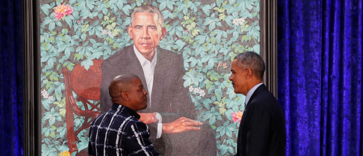 Former U.S. President Barack Obama greets artist Kehinde Wiley during the unveiling of his portrait at the Smithsonian�s National Portrait Gallery in Washington, U.S., February 12, 2018. REUTERS/Jim Bourg