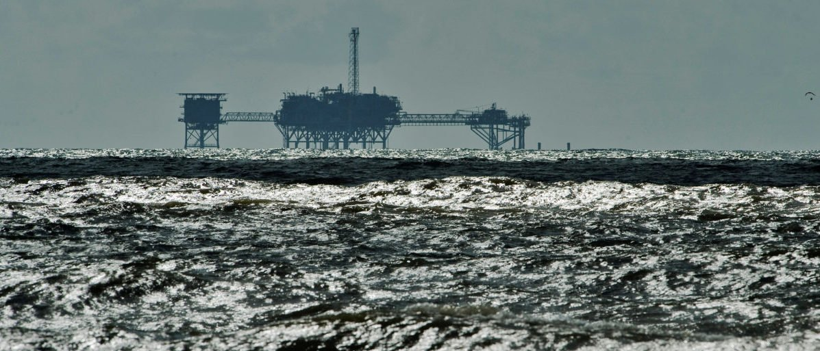 An oil and gas drilling platform stands offshore near Dauphin Island, Alabama