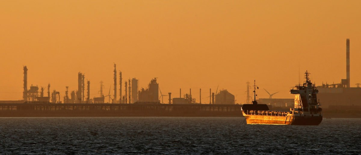 Oil tanker is seen at sunset anchored off the Fos-Lavera oil hub near Marseille