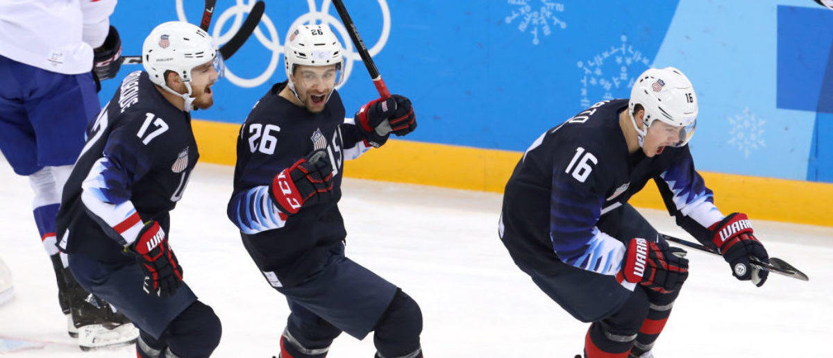 Ryan Donato #16 of the United States, Mark Arcobello #26 of the United States and Chris Bourque #17 of the United States celebrate after Donato scores against Slovakia during the Men's Ice Hockey Preliminary Round Group B game at Gangneung Hockey Centre on February 16, 2018 in Gangneung, South Korea. (Photo by Bruce Bennett/Getty Images)