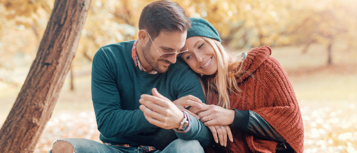 Dating in the park. Romantic couple has beautiful moments of happiness and joy in the autumn park. Love and tenderness. Shutterstock/Bobex-73