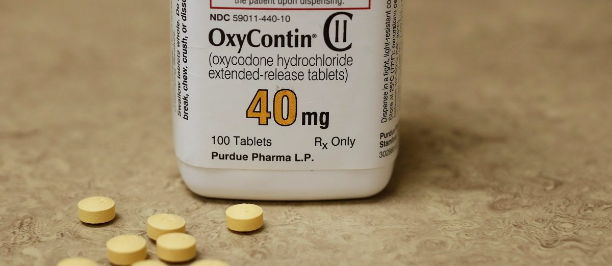 A bottle of prescription painkiller OxyContin, 40mg pills, made by Purdue Pharma L.D. sit on a counter at a local pharmacy, in Provo, Utah, U.S., April 25, 2017. REUTERS/George Frey