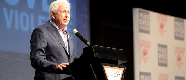 LOS ANGELES, CA - APRIL 23: Co-founder of Guess? Inc. Paul Marciano speaks onstage at the GUESS and Peace Over Violence celebration of the 15th anniversary of Denim Day at GUESS? Inc. Headquarters on April 23, 2014 in Los Angeles, California. (Photo by Jason Merritt/Getty Images for GUESS?)