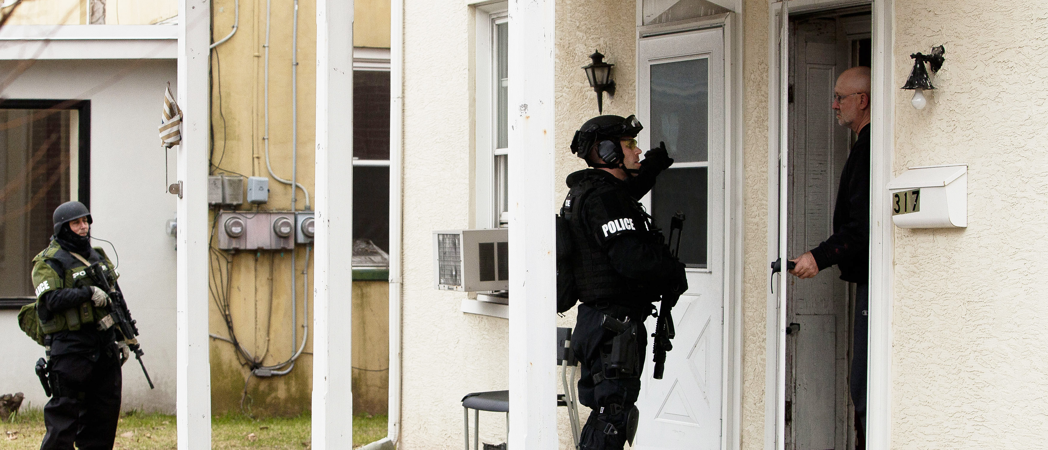 Police SWAT officers search for Bradley William Stone, 35, an Iraq war veteran suspected of fatally shooting and stabbing six family members in Pennsburg, Pennsylvania December 16, 2014. The search for Stone was focused around his hometown of Pennsburg, about 50 miles (80 km) northwest of Philadelphia, where residents were advised to stay inside with their doors locked, Montgomery County District Attorney Risa Vetri Ferman told a news conference.  REUTERS/Brad Larrison (UNITED STATES - Tags: CRIME LAW MILITARY TPX IMAGES OF THE DAY) - TM3EACG125B01