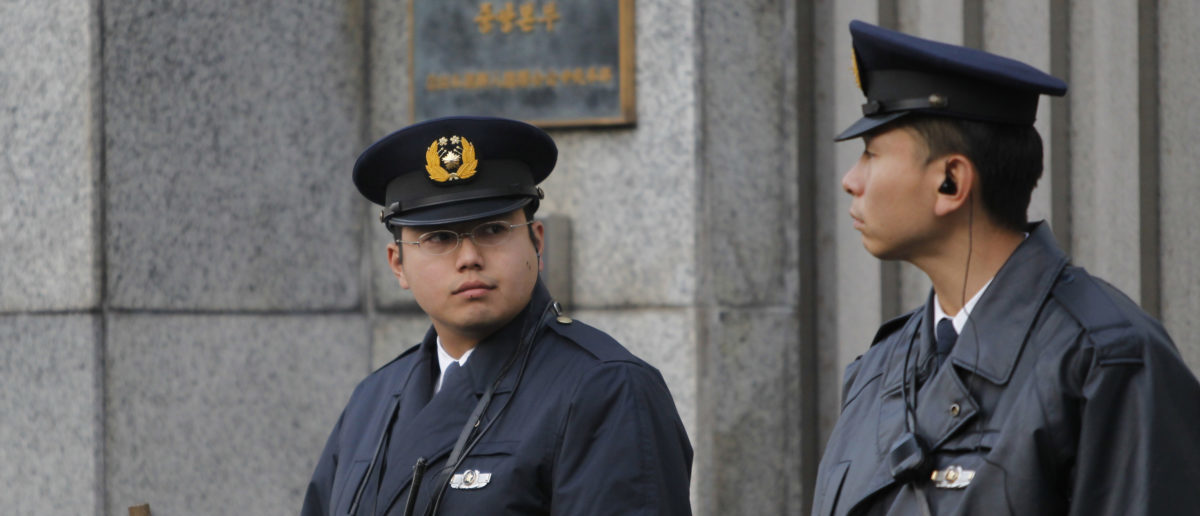 Police officers stand guard at the entrance to the headquarters of the pro-Pyongyang General Association of Korean Residents in Japan (Chongryon), in Tokyo December 19, 2011. North Korean leader Kim Jong-il died on a train trip on Saturday, state television reported on Monday, sparking immediate concern over who is in control of the reclusive state and its nuclear programme. REUTERS/Toru Hanai
