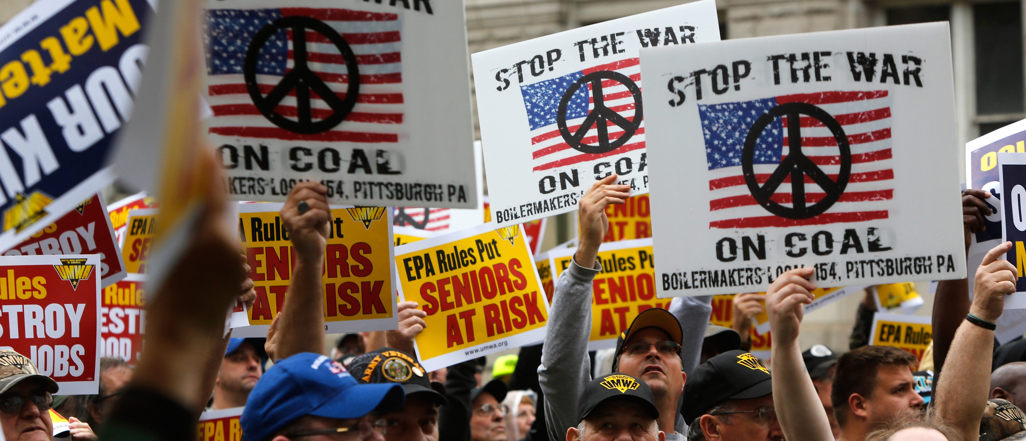 Members of United Mine Workers of America hold a rally outside the U.S. Environmental Protection Agency (EPA) headquarters in Washington October 7, 2014. The coal miner's union members rallied against proposed EPA Clean Power Plan rules, which the union claims will eliminate thousands of coal industry-related jobs. REUTERS/Jonathan Ernst