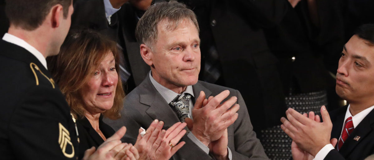 American student Otto Warmbier's parents Fred and Cindy Warmbier applaud as U.S. President Donald Trump talks about the death of their son Otto after his arrest in North Korea during the State of the Union address to a joint session of the U.S. Congress on Capitol Hill in Washington, U.S. January 30, 2018. REUTERS/Jonathan Ernst