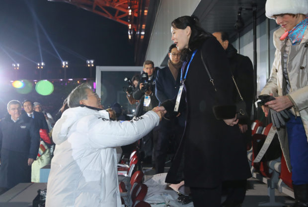 South Korean President Moon Jae-in shakes hands with Kim Jong Un's younger sister Kim Yo Jong at the Winter Olympics opening ceremony in Pyeongchang, South Korea February 9, 2018. Yonhap via REUTERS