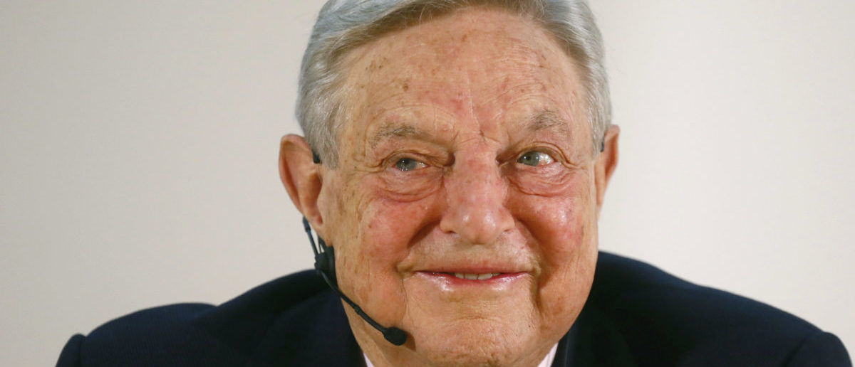 George Soros, Chairman of Soros Fund Management LLC smiles as he addresses the audience during an economic speech in Frankfurt April 9, 2013, on the topic 'How to save the European Union from the euro crisis.' Photo: REUTERS/Ralph Orlowski
