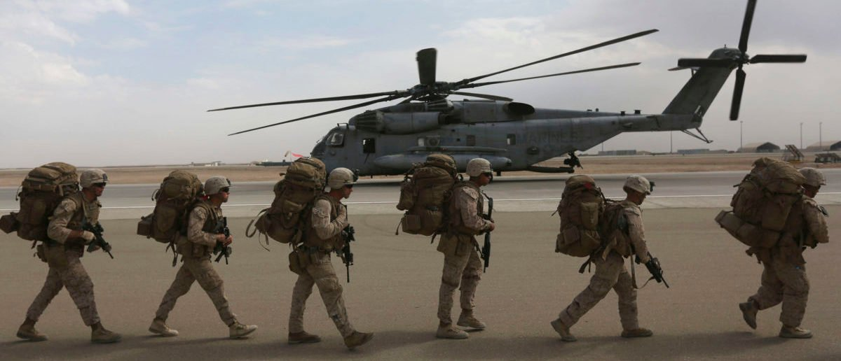 Marines boarding a helicopter in southern Afghanistan. REUTERS/Omar Sobhani