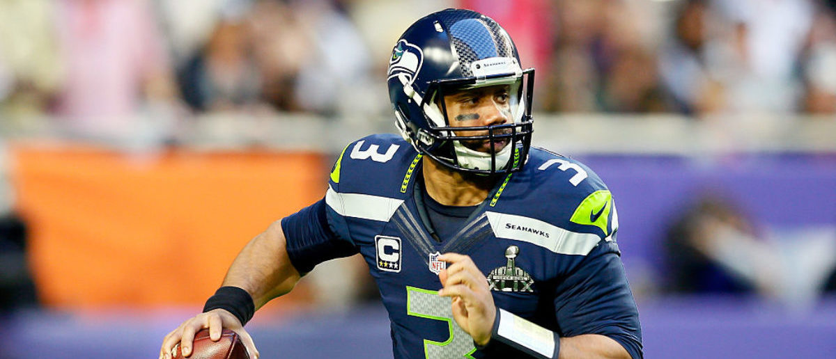 GLENDALE, AZ - FEBRUARY 01:  Russell Wilson #3 of the Seattle Seahawks looks to pass in the first quarter against the New England Patriots during Super Bowl XLIX at University of Phoenix Stadium on February 1, 2015 in Glendale, Arizona.  (Photo by Kevin C. Cox/Getty Images)