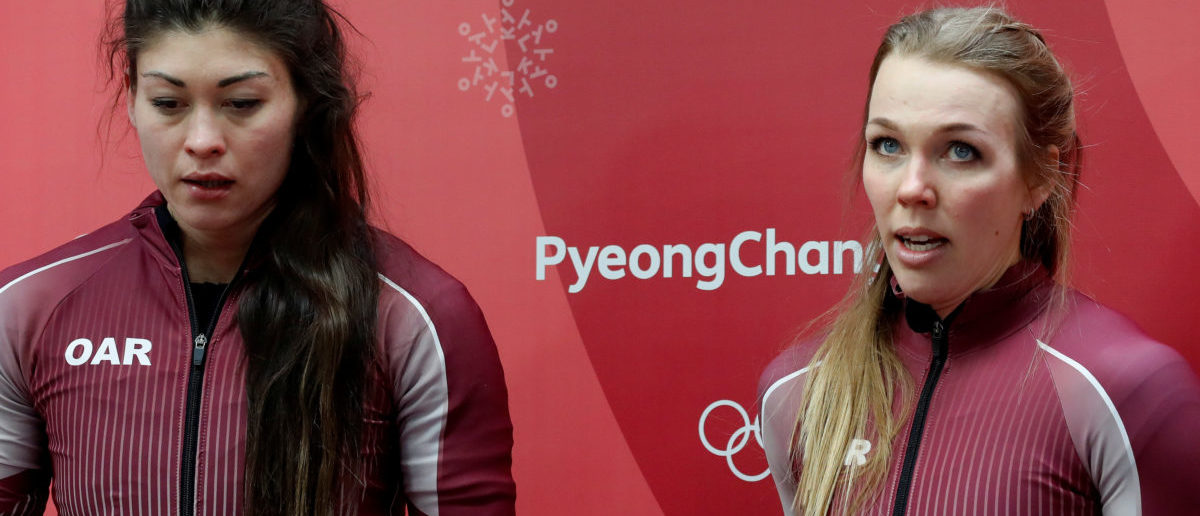 Bobsleigh - Pyeongchang 2018 Winter Olympics - Women's Finals - Olympic Sliding Centre - Pyeongchang, South Korea - February 21, 2018 - Olympic athletes from Russia Nadezhda Sergeeva and Anastasia Kocherzhova react. Picture taken February 21, 2018. REUTERS/Arnd Wiegmann