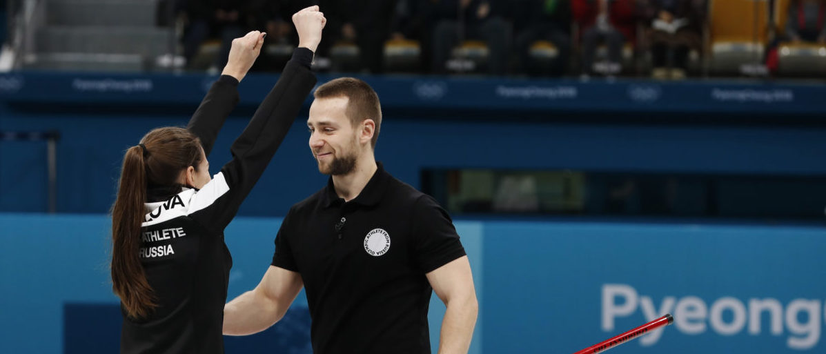 Curling � Pyeongchang 2018 Winter Olympics � Mixed Doubles Bronze Medal Match - Olympic Athletes from Russia v Norway - Gangneung Curling Center - Gangneung, South Korea � February 13, 2018 - Aleksandr Krushelnitckii and Anastasia Bryzgalova, Olympic athletes from Russia, celebrate after winning the bronze. Picture taken February 13, 2018. REUTERS/Cathal McNaughton