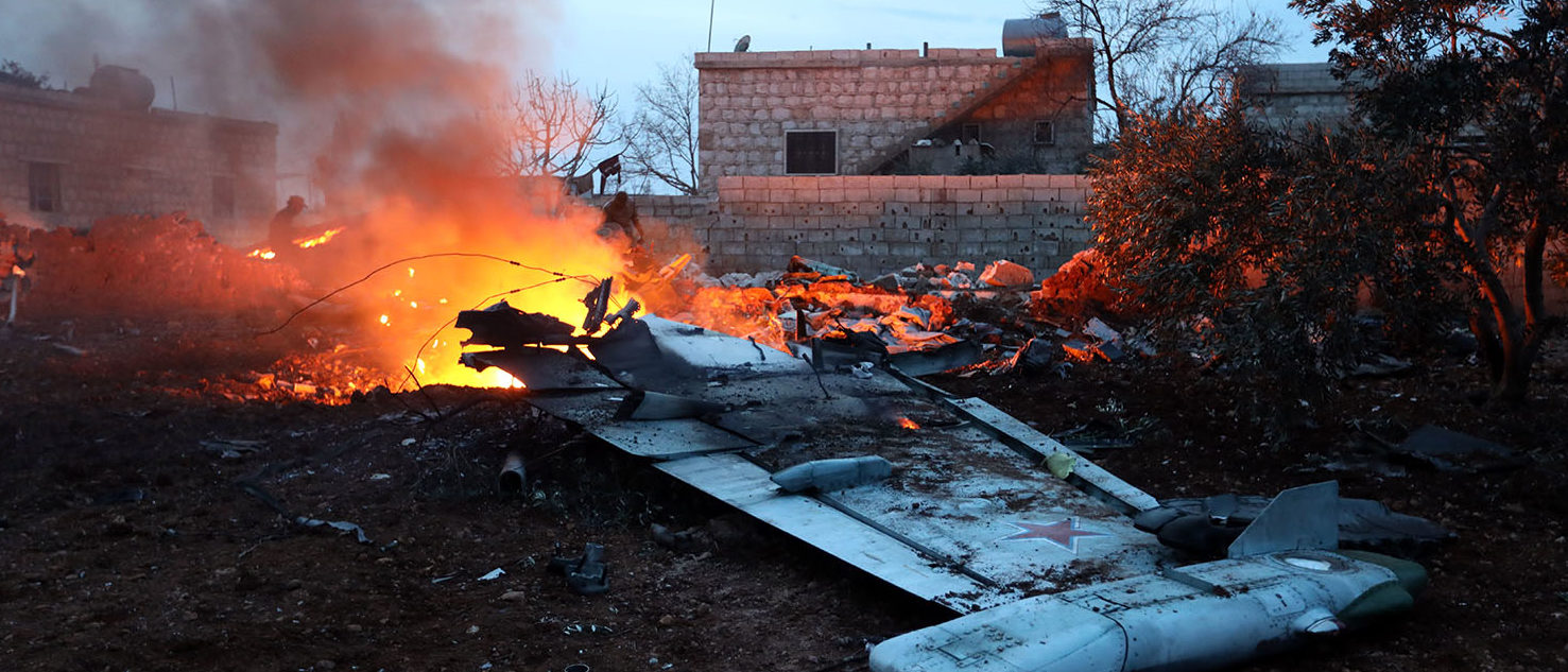 Rebel fighters shot down a Russian plane over Syria's northwest Idlib province and captured its pilot, the Syrian Observatory for Human Rights said. OMAR HAJ KADOUR/AFP/Getty Images