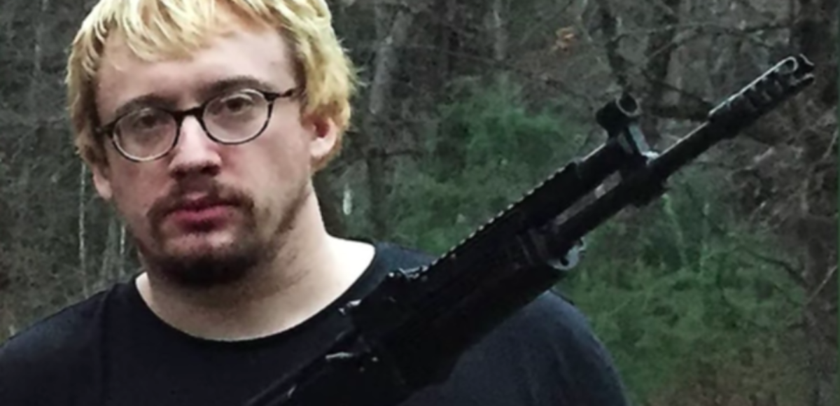 Alt-right comedian Sam Hyde poses with a weapon (YouTube/Screenshot/Mashable Daily)