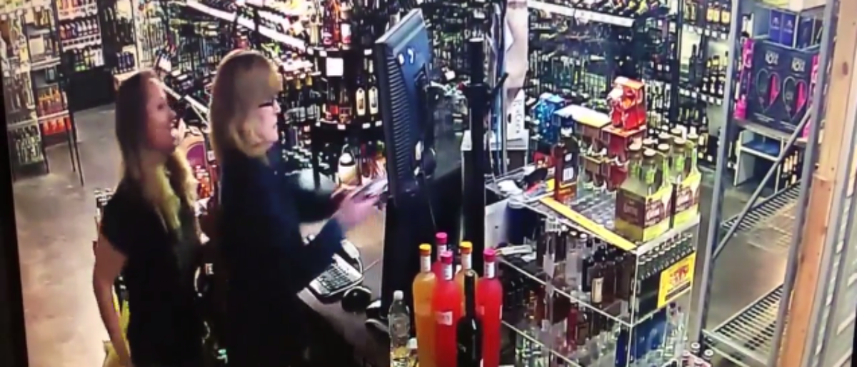 A mother and daughter defend their liquor store. (Screenshot/Tulsa KTUL)