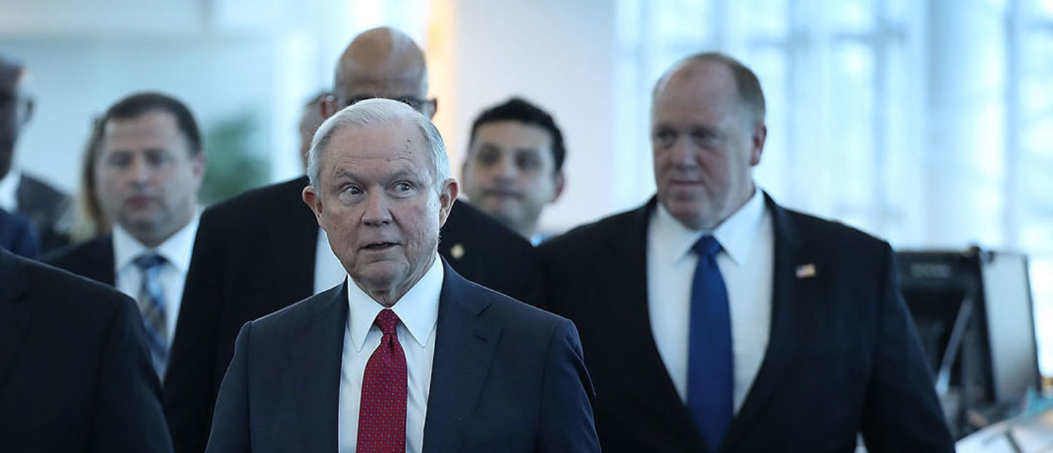 U.S. Attorney General Jeff Sessions arrives with Miami-Dade Mayor Carlos Gimenez (2nd L) for a speech at PortMiami on what he said is a growing trend of violent crime in sanctuary cities on August 16, 2017 in Miami, Florida. The speech highlighted jurisdictions like Miami-Dade that Mr. Sessions told the audience have increased their cooperation and information sharing with federal immigration authorities and have demonstrated a fundamental commitment to the rule of law and lowering violent crime. (Photo by Joe Raedle/Getty Images)