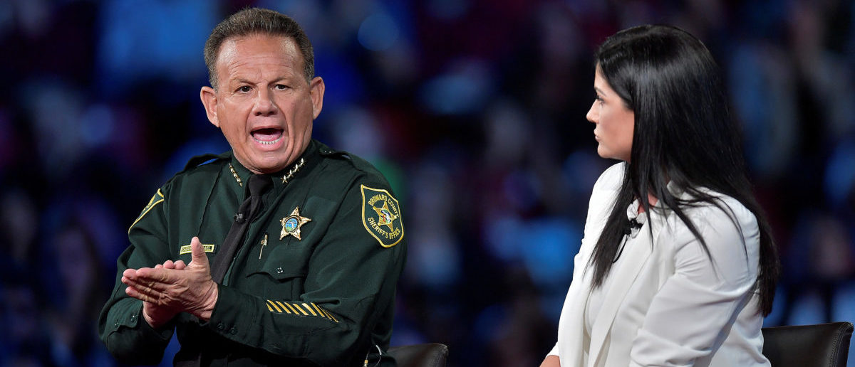 Broward Sheriff Scott Israel (L) makes a point to NRA Spokesperson Dana Loesch during a CNN town hall meeting, at the BB&T Center, in Sunrise, Florida, U.S. February 21, 2018. REUTERS/Michael Laughlin
