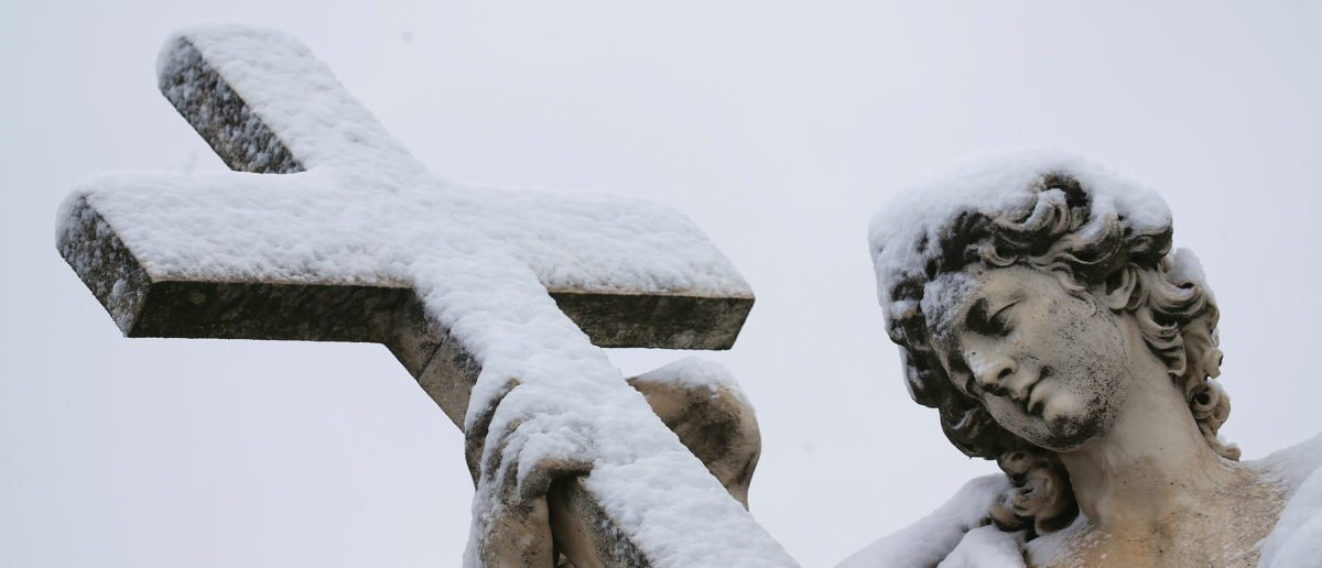 A statue is seen covered in snow during a heavy snowfall in Rome