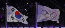 Pyeongchang 2018 Winter Olympics – Opening ceremony – Pyeongchang Olympic Stadium - Pyeongchang, South Korea – February 9, 2018 - The South Korean flag and the Olympic flag. REUTERS/Damir Sagolj