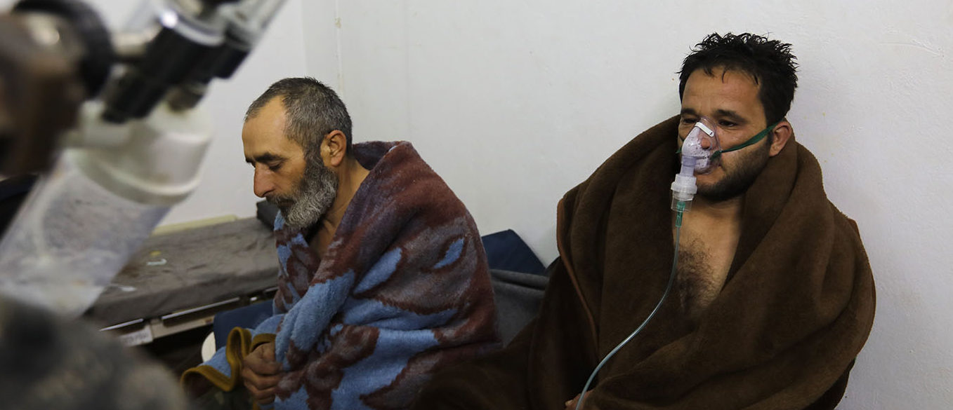 """Five people were treated for """"suffocation"""" after Syrian regime air strikes on the northwestern town of Saraqeb, the Britain-based Syrian Observatory for Human Rights reported, adding that 10 civilians were killed in southern Idlib province. AFP PHOTO / OMAR HAJ KADOUR / Getty Images"""