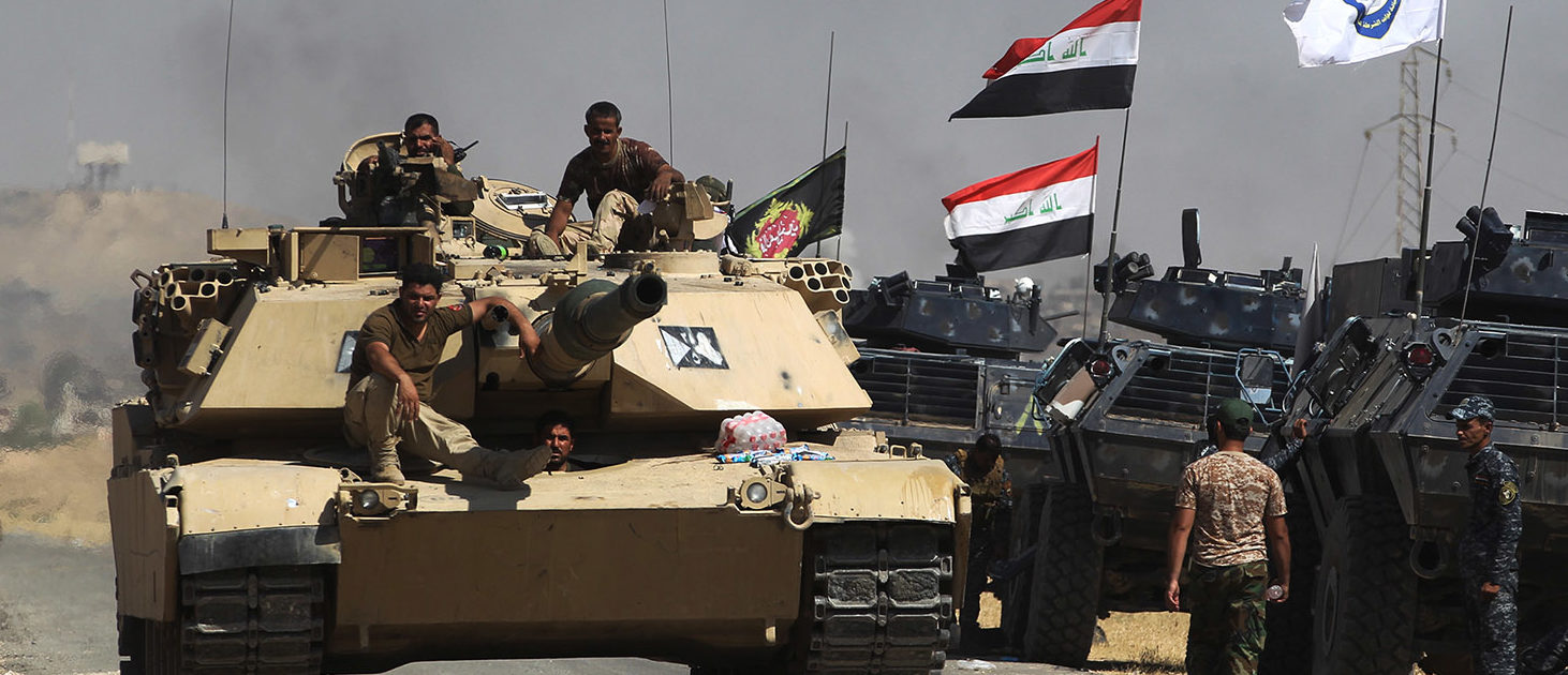 Iraqi forces take position on a road as they advance towards Al-Ayadieh village, the last remaining active front line near Tal Afar, during an operation to retake the city from the Islamic State (IS) group on August 29, 2017. / AFP PHOTO / AHMAD AL-RUBAYE (Photo credit should read AHMAD AL-RUBAYE/AFP/Getty Images)