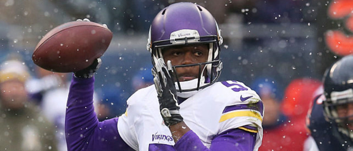CHICAGO, IL - NOVEMBER 16: Teddy Bridgewater #5 of the Minnesota Vikings looks to pass during the first quarter of a game against the Chicago Bears at Soldier Field on November 16, 2014 in Chicago, Illinois. (Photo by Jonathan Daniel/Getty Images)