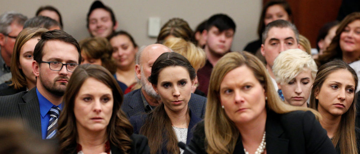 Victim Rachael Denhollander (C) listens as Larry Nassar, a former team USA Gymnastics doctor who pleaded guilty in November 2017 to sexual assault charges, is sentenced in Lansing, Michigan, U.S., January 24, 2018. REUTERS/Brendan McDermid