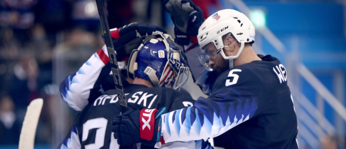 Ryan Zapolski #30 amd Noah Welch #5 of the United States celebrate after defeating Team Slovakia in the Men's Play-offs Qualifications game on day eleven of the PyeongChang 2018 Winter Olympic Games at Gangneung Hockey Centre on February 20, 2018 in Gangneung, South Korea. (Photo by Ronald Martinez/Getty Images)