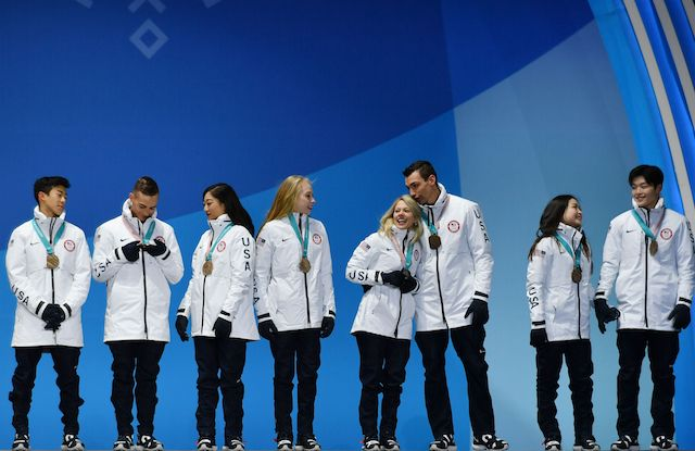 The USA team who won bronze pose on the podium during the medal ceremony for the figure skating team event at the Pyeongchang Medals Plaza during the Pyeongchang 2018 Winter Olympic Games in Pyeongchang on February 12, 2018. / AFP PHOTO / Fabrice COFFRINI (Photo credit should read FABRICE COFFRINI/AFP/Getty Images)