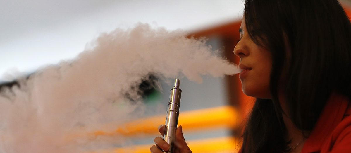 Enthusiast Brandy Tseu uses an electronic cigarette at The Vapor Spot vapor bar in Los Angeles, California March 4, 2014. The Los Angeles City Council voted unanimously on Tuesday to ban the use of electronic cigarettes, popularly known as