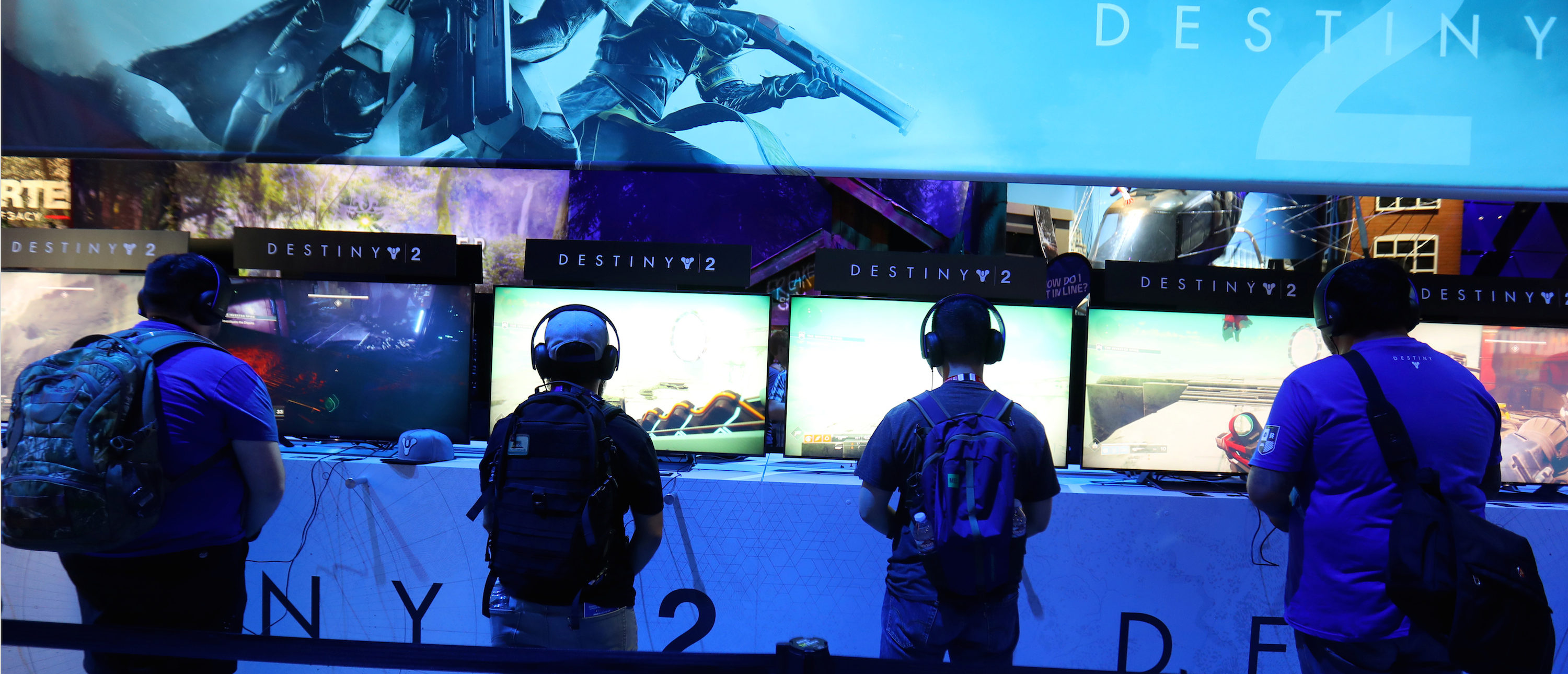 Attendees play video games at the E3 2017 Electronic Entertainment Expo in Los Angeles, June 13, 2017. REUTERS/ Mike Blake