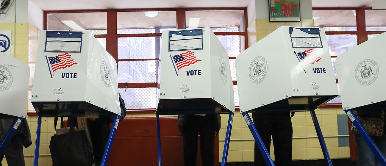 Voters cast their ballots at voting booths at PS198M The Straus School on November 8, 2016 in New York, United States.  (Photo by Michael Reaves/Getty Images)