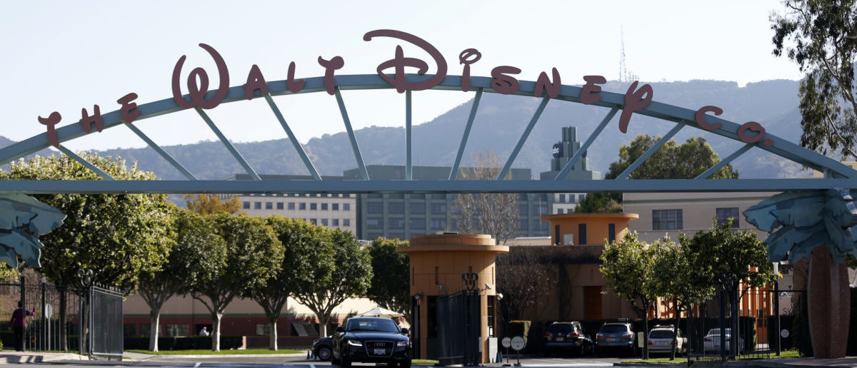 """The entrance gate to The Walt Disney Co is pictured in Burbank, California February 5, 2014. Media company Walt Disney Co reported higher profit for the quarter that ended in December, beating Wall Street expectations due to growth at sports network ESPN and the blockbuster performance of its animated hit film """"Frozen."""" REUTERS/Mario Anzuoni"""