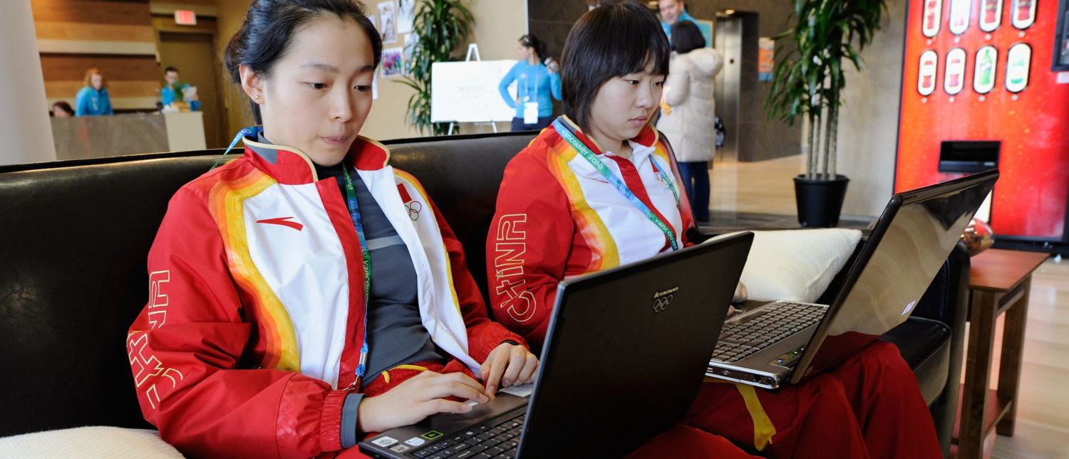 VANCOUVER, BC - FEBRUARY 09: (L-R) Athlete's Liang Tang and Shuang Zhang of China work on their laptops inside the athlete's village ahead of the Vancouver 2010 Winter Olympics on February 9, 2010 in Vancouver, Canada. (Photo by Kevork Djansezian/Getty Images)