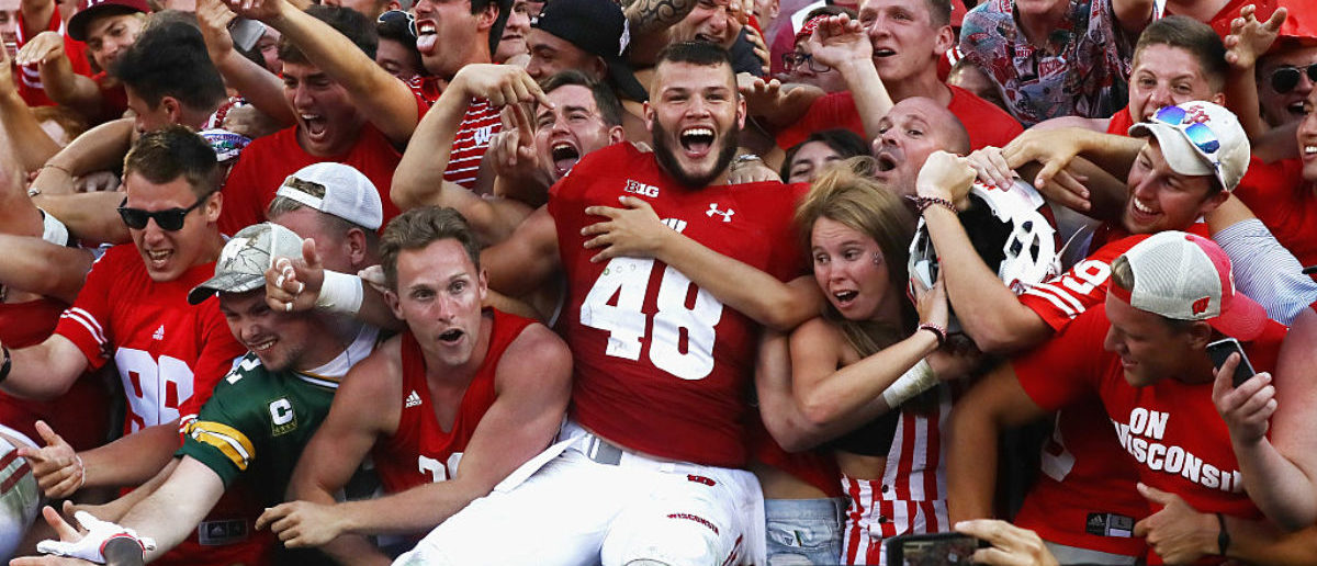 GREEN BAY, WI - SEPTEMBER 03: Jack Cichy #48 of the Wisconsin Badgers celebrates with fans after defeating the LSU Tigers 16-14 at Lambeau Field on September 3, 2016 in Green Bay, Wisconsin. (Photo by Jonathan Daniel/Getty Images)