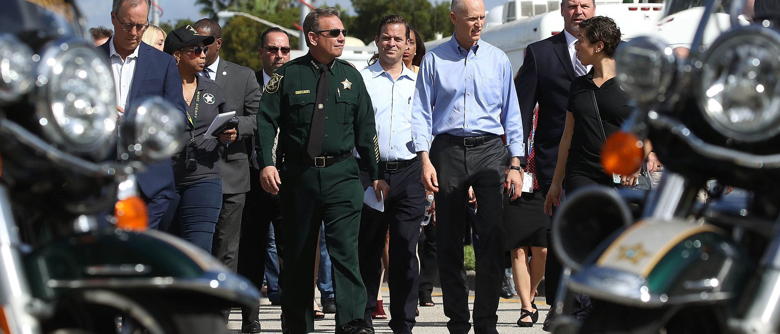 PARKLAND, FL - FEBRUARY 15: Florida Governor Rick Scott,(R), and Broward County Sheriff, Scott Israel (L), walk up to the media to speak about the mass shooting at Marjory Stoneman Douglas High School where 17 people were killed yesterday, on February 15, 2018 in Parkland, Florida. Police arrested the suspect after a short manhunt, and have identified him as 19 year old former student Nikolas Cruz. (Photo by Mark Wilson/Getty Images)