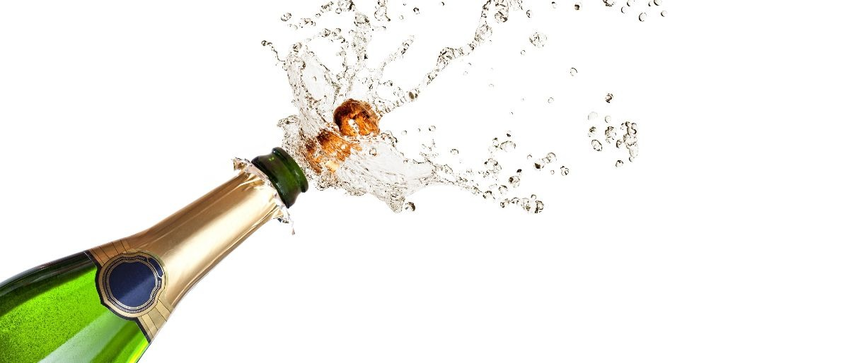 celebration champagne cork pop Shutterstock/gualtiero boffi