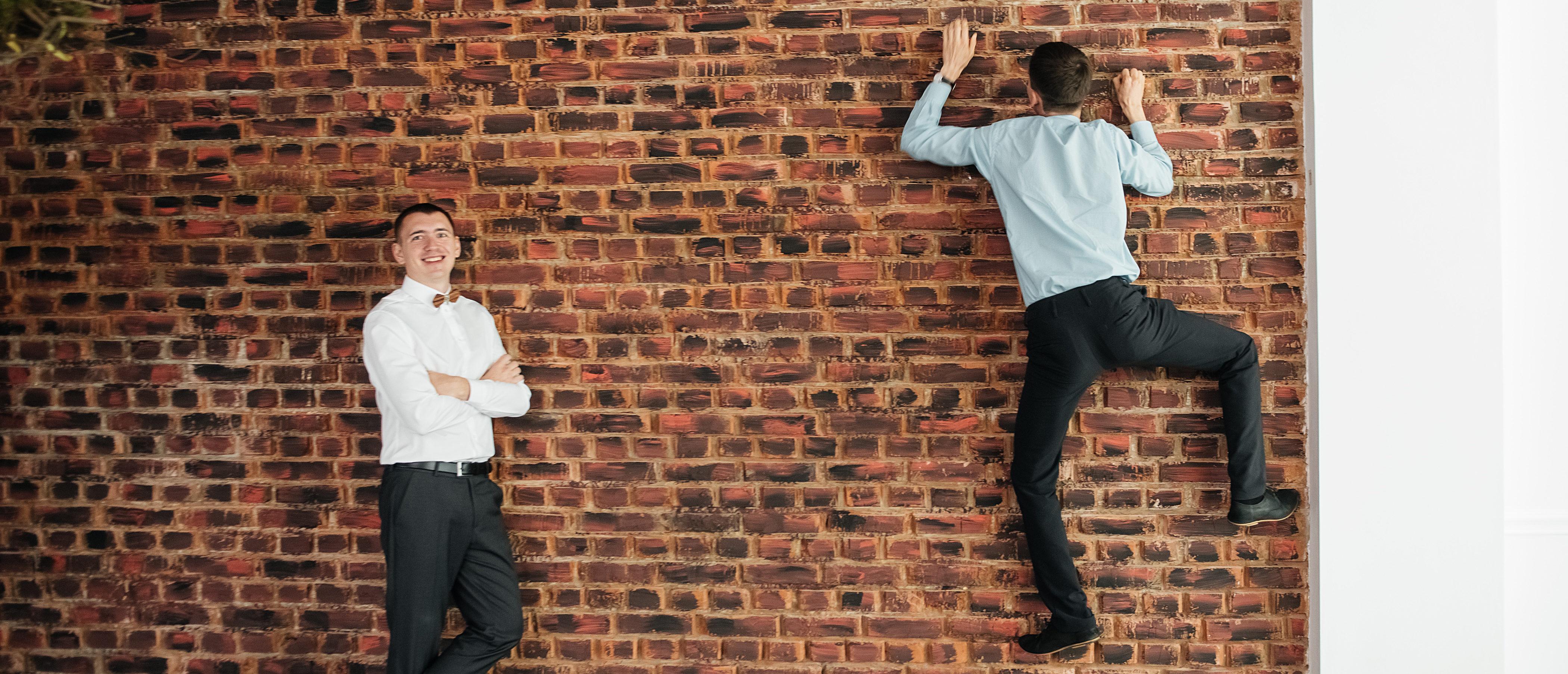 Climbing A Wall Shutterstock