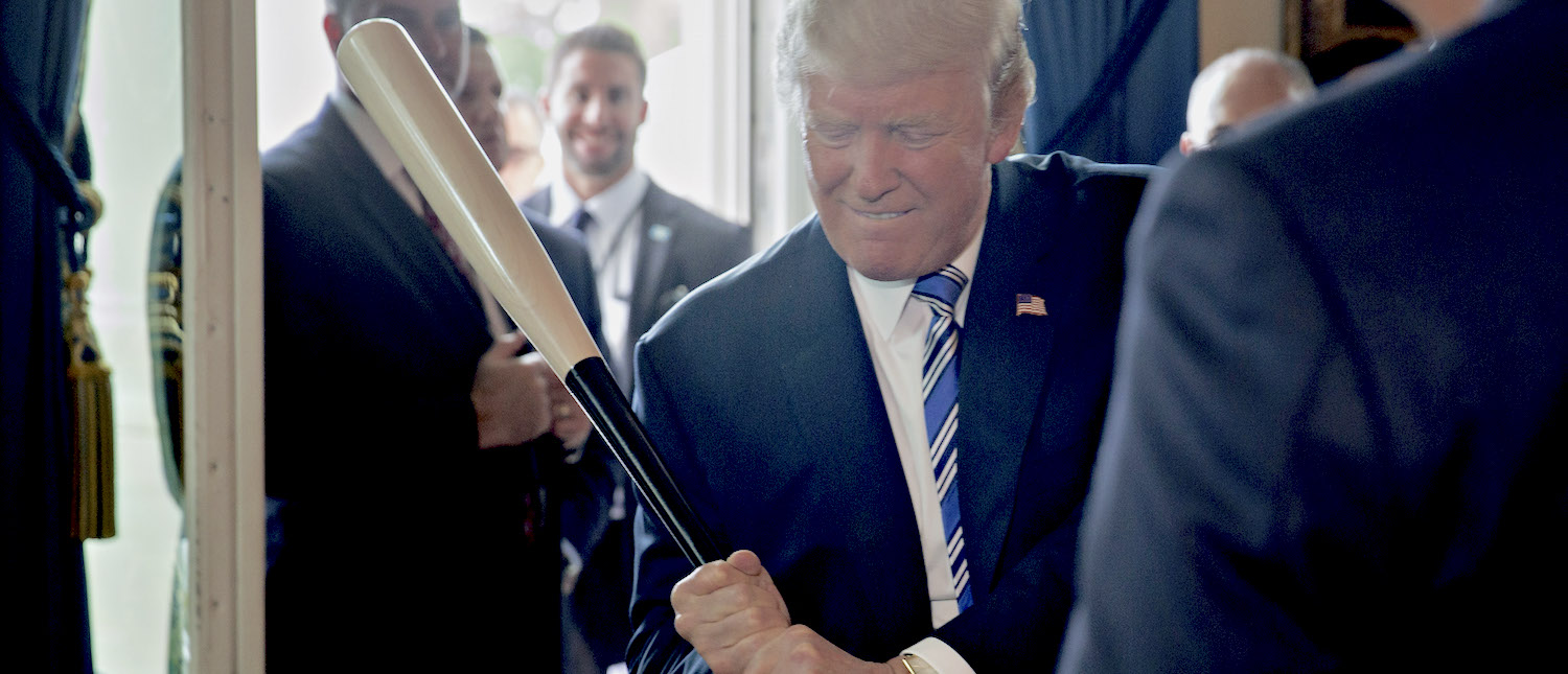 U.S. President Donald Trump holds a baseball bat while participating in a Made in America event with companies from 50 states featuring their products in the Blue Room of the White House July 17, 2017 in Washington, DC.  (Photo: Andrew Harrer-Pool/Getty Images)