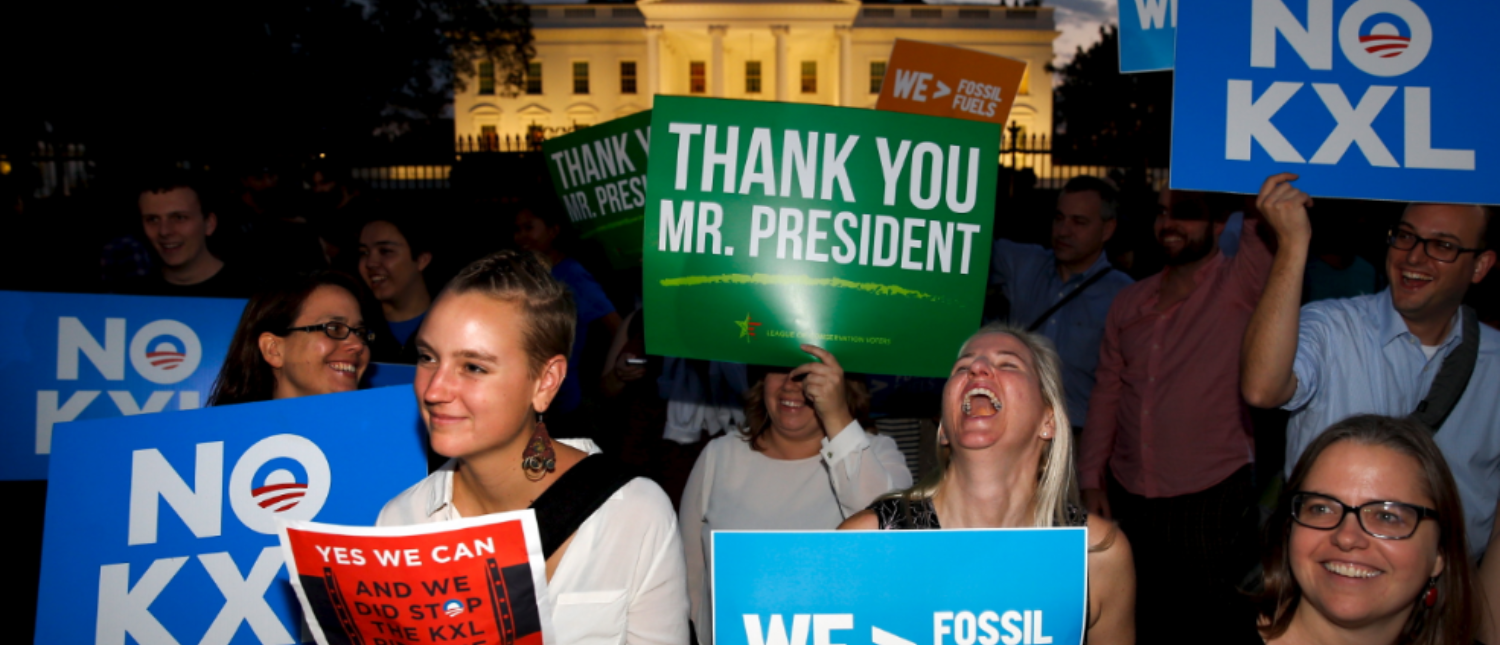 A small group of activists gather to celebrate the Obama administration's rejection of the Keystone XL pipeline, outside the White House in Washington November 6, 2015. U.S. President Barack Obama on Friday rejected the proposed Keystone XL oil pipeline from Canada in a victory for environmentalists who campaigned against the project for more than seven years. REUTERS/Jonathan Ernst TPX IMAGES OF THE DAY