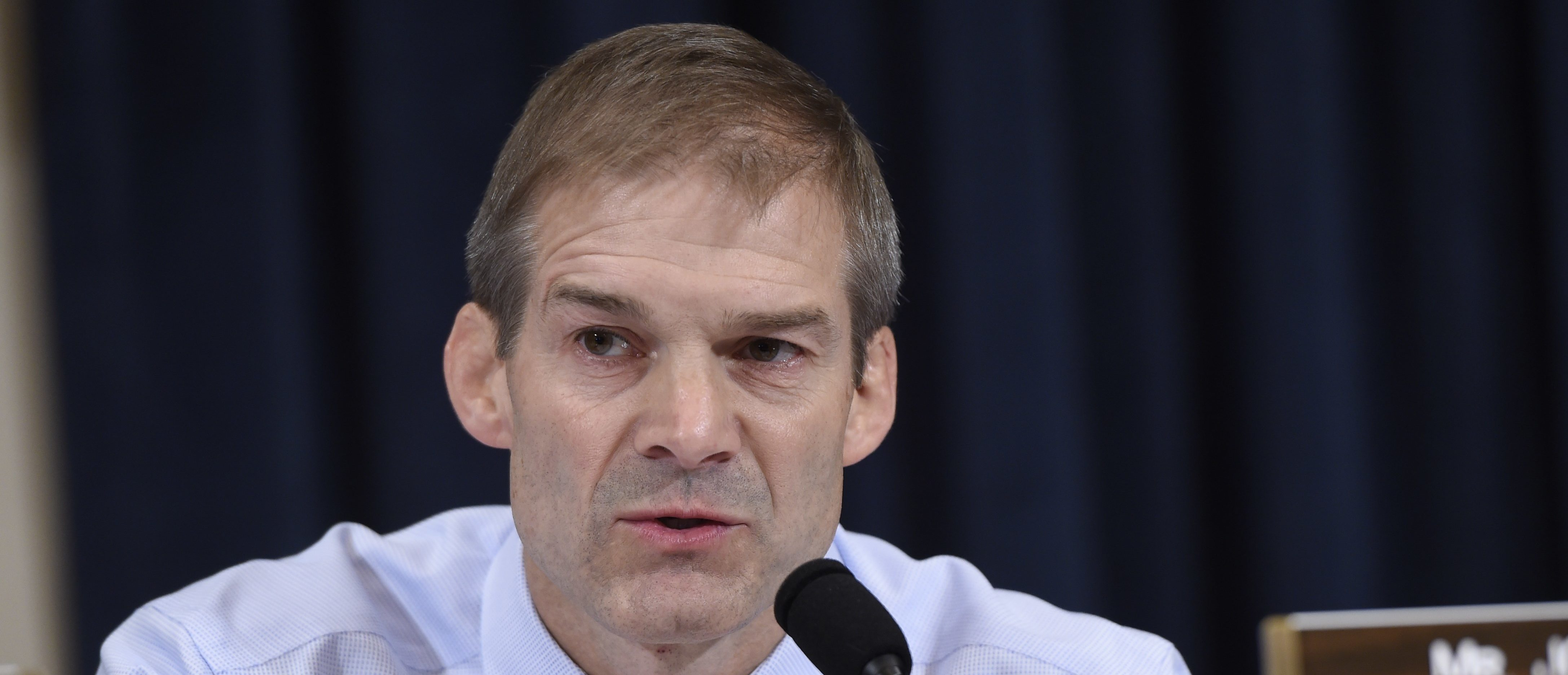 Republican US Representative from Ohio Jim Jordan questions former US Secretary of State and Democratic Presidential hopeful Hillary Clinton as she testifies before the House Select Committee on Benghazi on Capitol Hill in Washington, DC, October 22, 2015 (SAUL LOEB/AFP/Getty Images)
