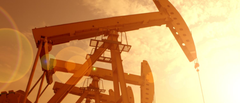 An oil pump set to orange sunset (huyangshu/Shutterstock)