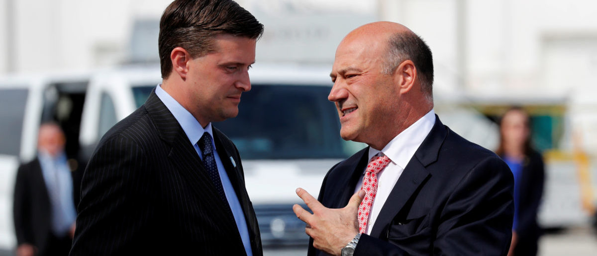 White House chief economic adviser Gary Cohn (R) talks with White House Staff Secretary Rob Porter (L) as they arrive with U.S. President Donald Trump aboard Air Force One at Indianapolis International Airport in Indianapolis, Indiana, U.S. September 27, 2017. REUTERS/Jonathan Ernst