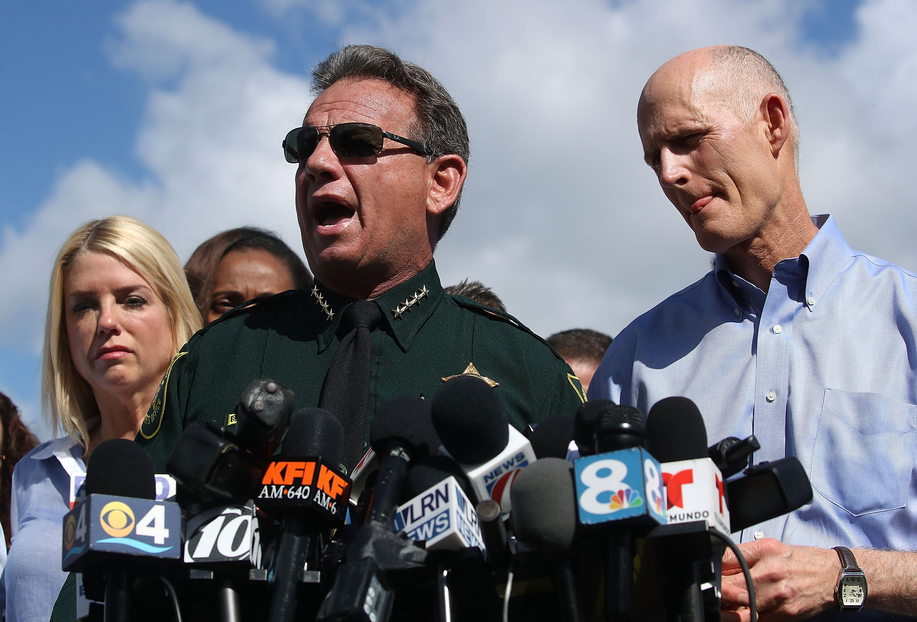 PARKLAND, FL - FEBRUARY 15: Broward County Sheriff, Scott Israel (C), Florida Governor Rick Scott,(R),and Florida Attorney General Pam Bondi,(L), speak to the media about the mass shooting at Marjory Stoneman Douglas High School where 17 people were killed yesterday, on February 15, 2018 in Parkland, Florida. Police arrested the suspect after a short manhunt, and have identified him as 19 year old former student Nikolas Cruz. (Photo by Mark Wilson/Getty Images)