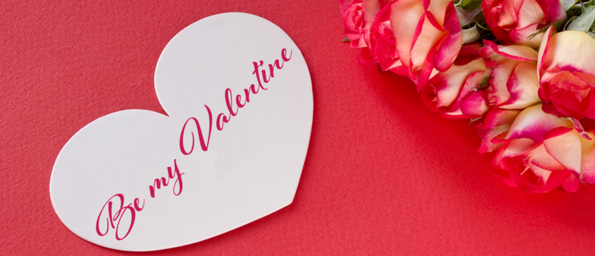 Valentine's day greeting card with roses hearts and lettering (Shutterstock: Helen_g)