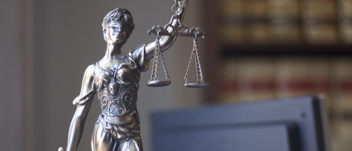 woman scales justice Shutterstock/edwardolive