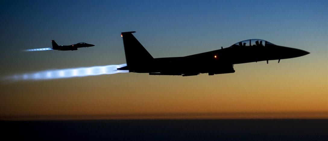 A pair of U.S. Air Force F-15E Strike Eagles fly over northern Iraq after conducting airstrikes against ISIL targets in Syria, Sept. 23, 2014