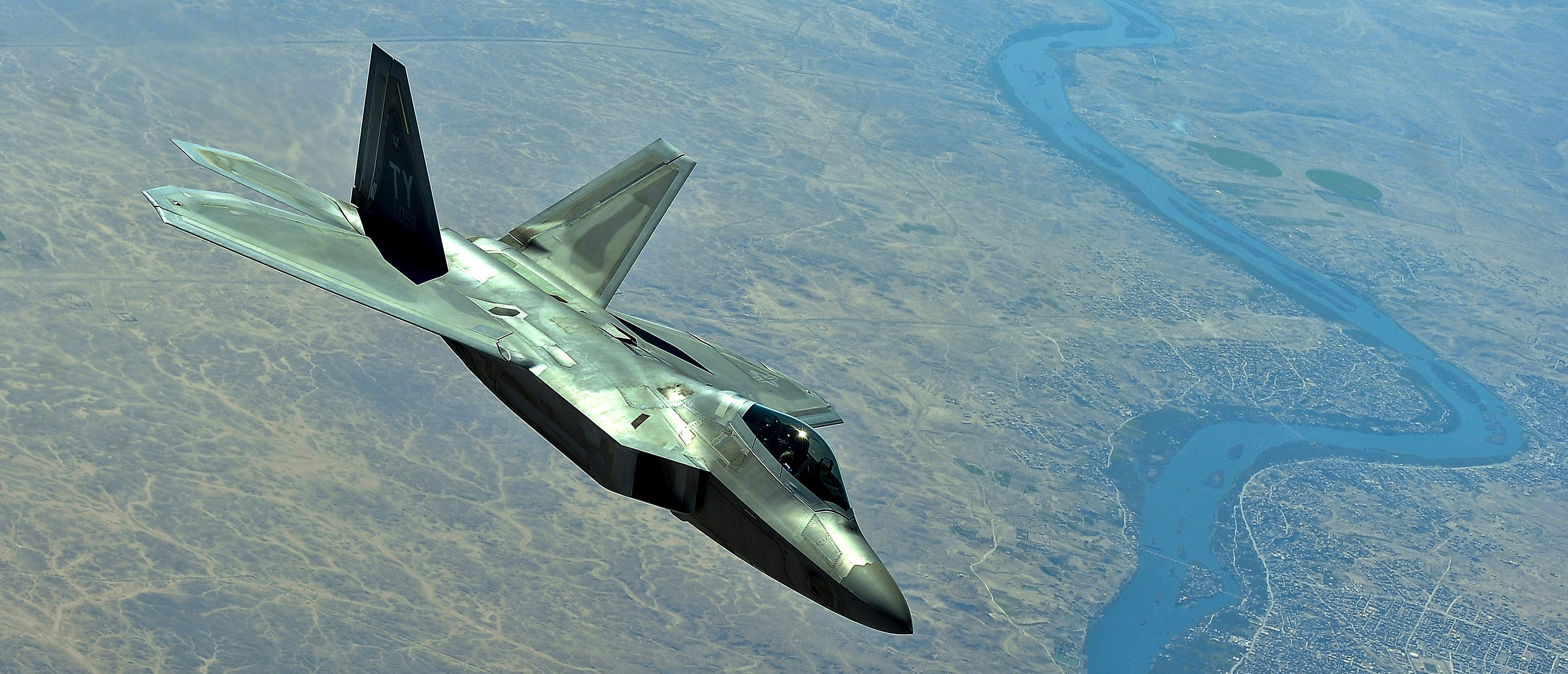 A U.S. Air Force F-22 assigned to the 380th Air Expeditionary Wing, Al Dhafra Air Base, United Arab Emirates disconnects from a KC-10 Extender after receiving fuel over Syria March 2,2018. (U.S. Air Force photo by Tech. Sgt. Anthony Nelson Jr.)