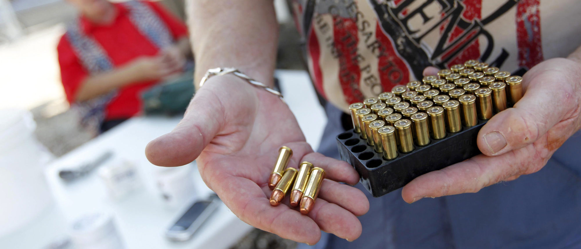 Doug Varrieur displays some .38 caliber ammunition on the firing range he set up in the yard of his home in Big Pine Key in the Florida Keys March 5, 2014. REUTERS/Andrew Innerarity
